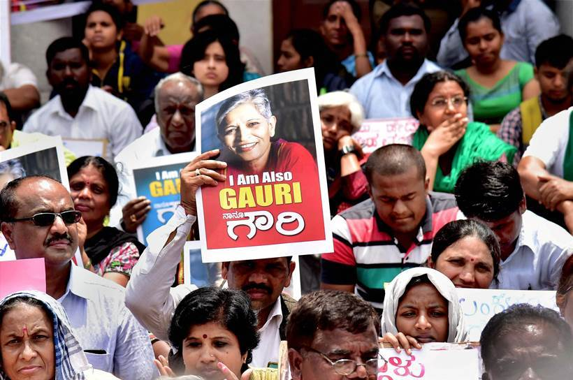 Bengaluru: Citizens with posters and placards during a protest against the killing of journalist Gauri Lankesh, who was shot dead by motorcycle-borne assailants outside her residence last night, during a protest in Bengaluru on Wednesday. PTI Photo by Shailendra Bhojak (PTI9_6_2017_000034A)